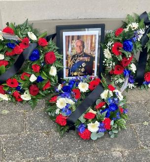 Decorative image showing wreaths laid in commemoration of HRH Prince Philip