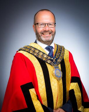 Portrait photo of Mayor of Basildon 2021-22 - Councillor David Dadds in mayoral robes and mayoral chain of office.
