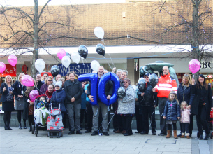 Photo of Councillor Blake, Chairman of Basildon Council's Leisure, Culture and Environment Committee leads a crowd announcing the Basildon at 70 celebrations