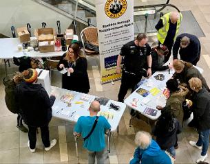 Photo showing members of the public interacting with members of the Safer Basildon partnership at Eastgate Shopping Centre