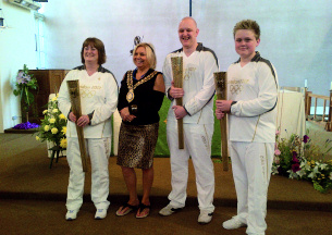 Heritage Photo of Basildon - 2012 - Olympic Torch bearers George, Tricia and Marc with Mayor Mo Larkin at Basildon's Olympic celebration in St Martins Church