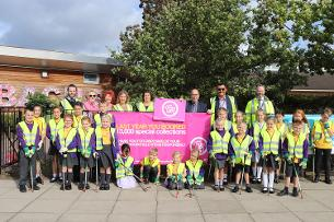 Decorative image showing a photo of Councillor Harrison joins pupils and teachers from Abacus Primary School, Wickford Wombles and Basildon Council officers for a We're cleaning-up campaign litter pick event.