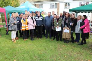 Decorative image showing Councillor Aidan McGurran with the council's partners on the Vange 3/4 estate