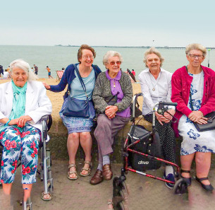 Decorative image showing Basildon Heroes - The Basildon Contact the Elderly team with clients at a day at the seaside