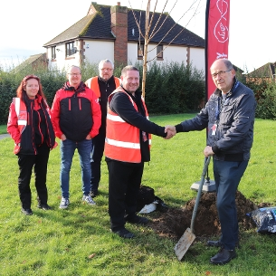 Decorative image showing Councillor David Harrison (right) with build engineer Michael Perrot and representatives of Virgin Media in Spayside Walk Wickford