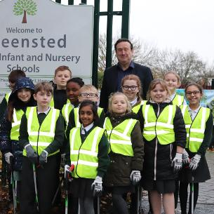 Decorative image showing Councillor Aidan McGurran with pupils at Greensted Junior School