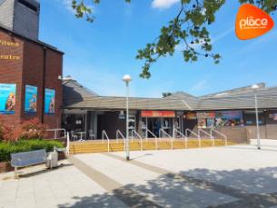 Decorative image shows a photo of The Place, Multi-purpose Leisure Centre