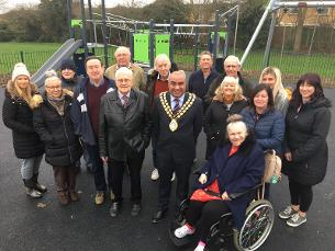 Decorative image showing the Mayor of Basildon Councillor David Burton-Sampson and Councillor Aidan McGurran with members of the Vange Community Group by the new play area