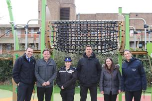 Decorative image showing members of the Project Play Whitmore team celebrating the installation of the new equipment