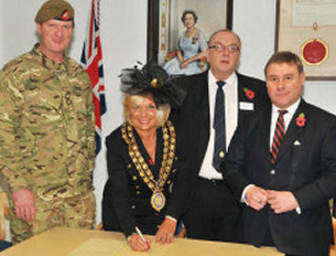 Image showing the signing of the Armed Forces Community Covenant